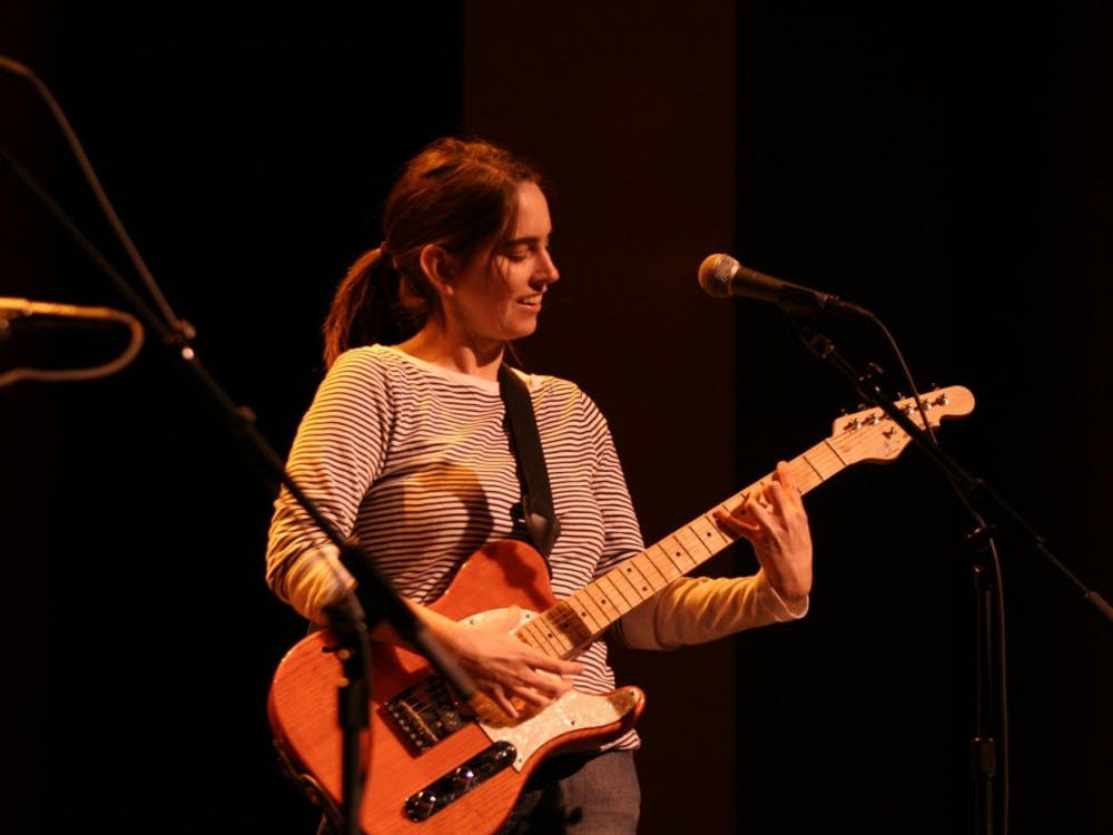 Erin Tobey, female singer-songwriter performed at the Buskirk Chumley on Sunday evening. The performance fused the likes of punk and folk aesethetics into a lively performance.