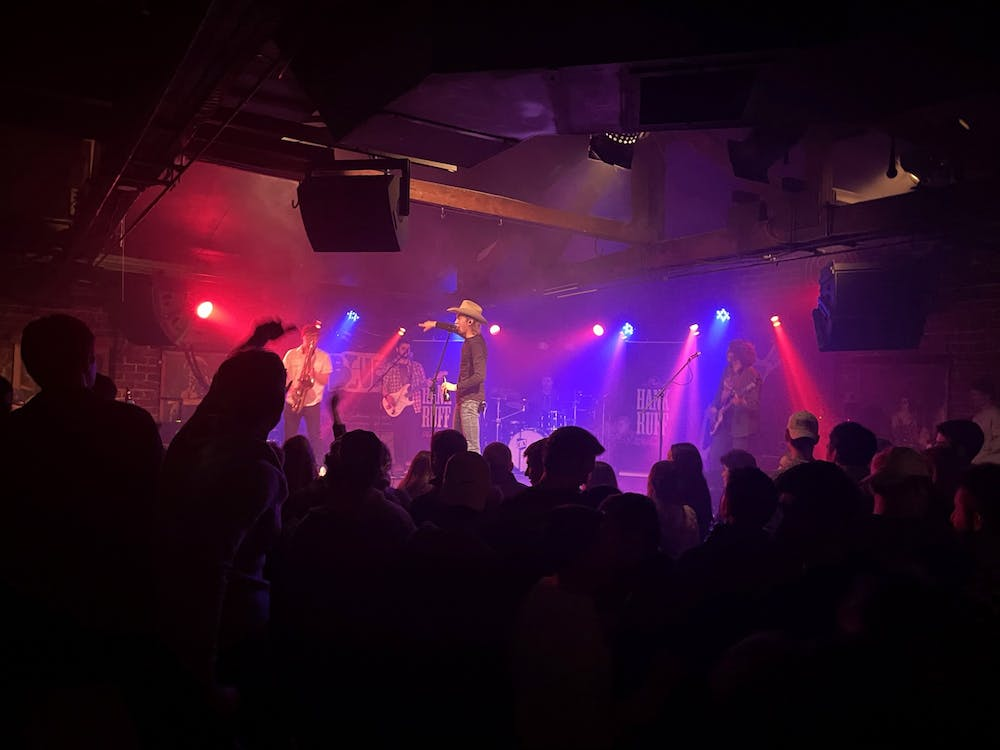 Local country artist Hank Ruff singles out the saxophonist in his band Feb. 13 at the Bluebird for the audience to applaud. Large in-person gatherings, like the crowd of around 200 people attending Ruff's show, are not advisable per CDC guidelines.