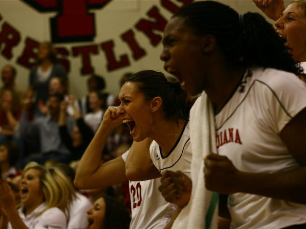 The Hoosiers celebrate their first round NCAA win again the University of Miami on Friday in University Gym.
