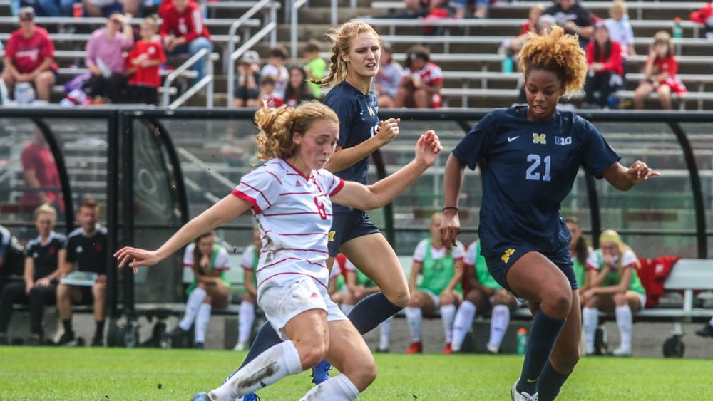 Junior midfielder Avery Lockwood goes to kick the ball Oct. 3, 2021, in Bill Armstrong Stadium against Michigan. Indiana lost its final regular-season game against No. 18 Purdue.