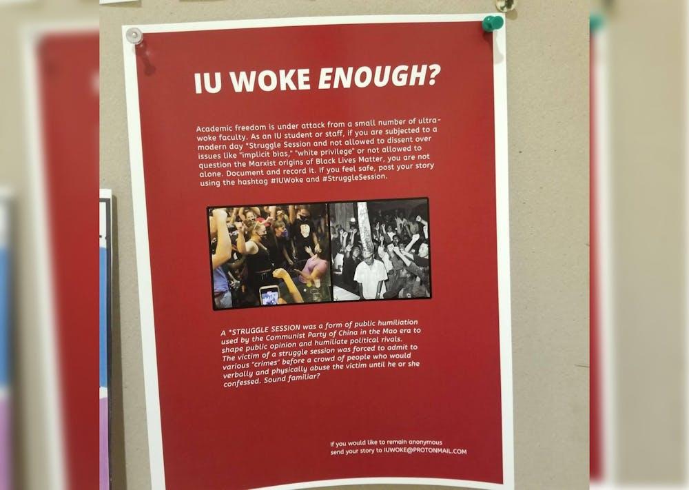 <p>A flier reading &quot;IU Woke Enough?&quot; hangs in Herman B Wells Library. </p>