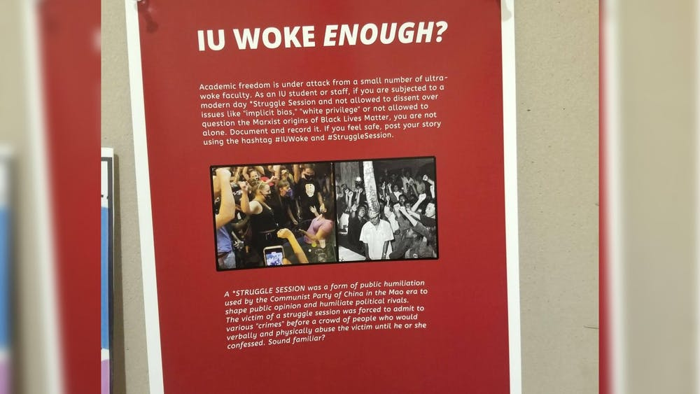 "A flier reading ""IU Woke Enough?"" hangs in Herman B Wells Library."