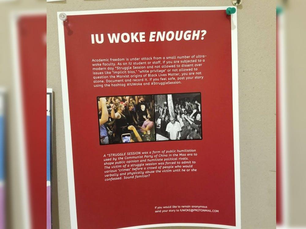 """A flier reading """"IU Woke Enough?"""" hangs in Herman B Wells Library."""