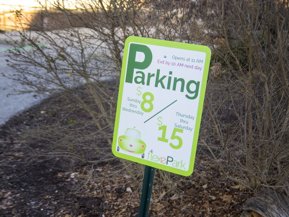 A sign for a FlexePark parking lot is seen Dec. 5 on Eighth Street. FlexePark is expanding to more locations in Bloomington.