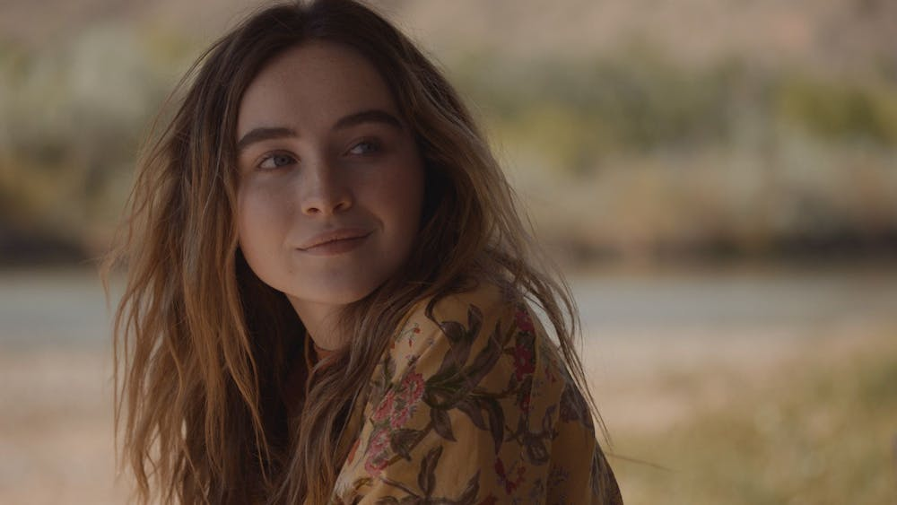 """Sabrina Carpenter looks over shoulder in Ani Simon-Kennedy's movie """"The Short History of the Long Road."""" In addition to being an actor, Carpenter is a singer who recently released her newest single """"Skin."""""""