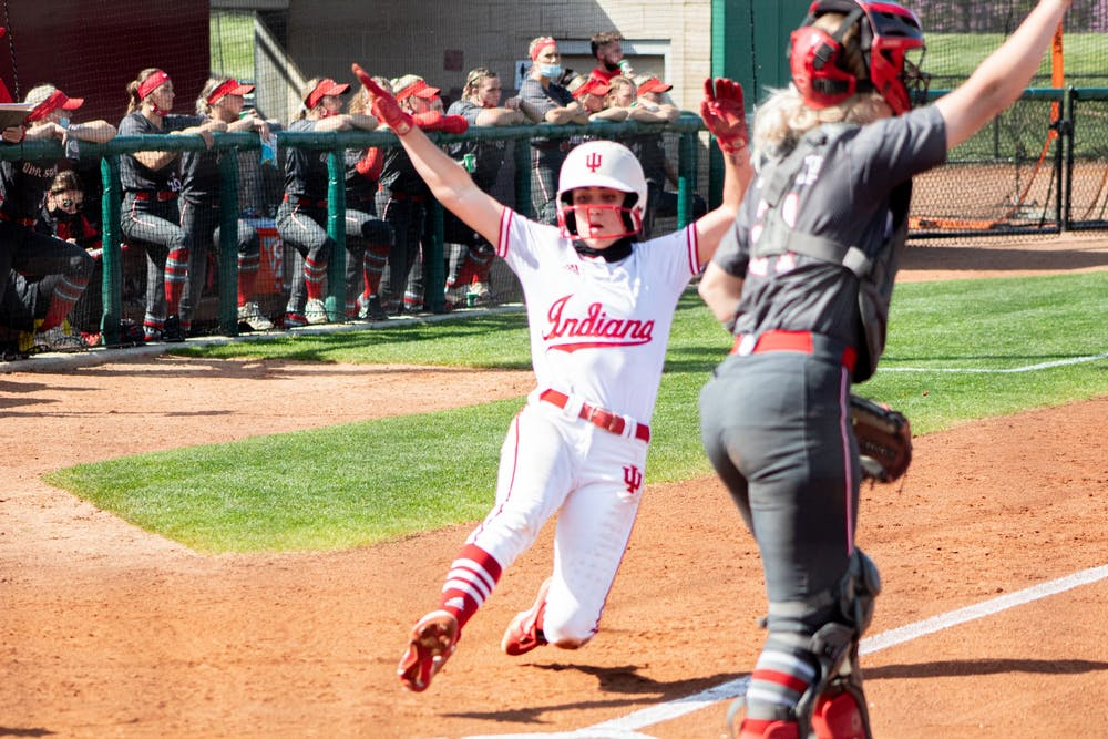 Senior Infielder Grayson Radcliffe slides home against Ohio State on April 16. IU softball swept Penn State this past weekend.
