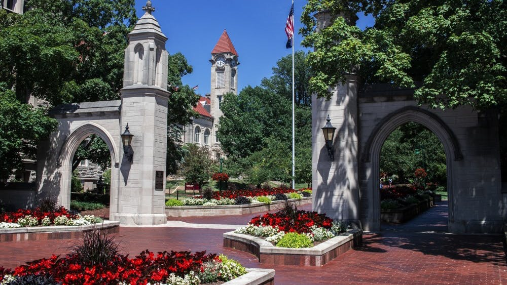 "Sunshine illuminates the Sample Gates on June 28 on the IU-Bloomington campus. IU""s Bicentennial began Monday at the start of the 2020 fiscal year."