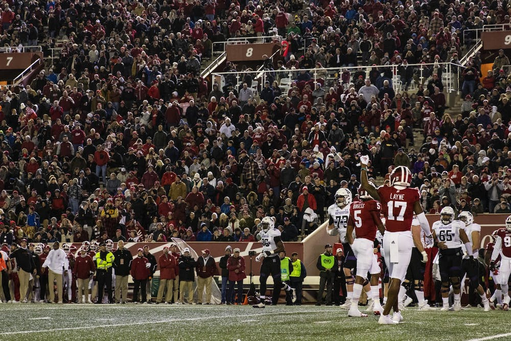 <p>Then-junior defensive back Raheem Layne puts his fist in the air during the second quarter against Northwestern on Nov. 2, 2019, at Memorial Stadium. IU said Wednesday it plans on allowing an unspecified number of spectators at IU football games this fall.</p>