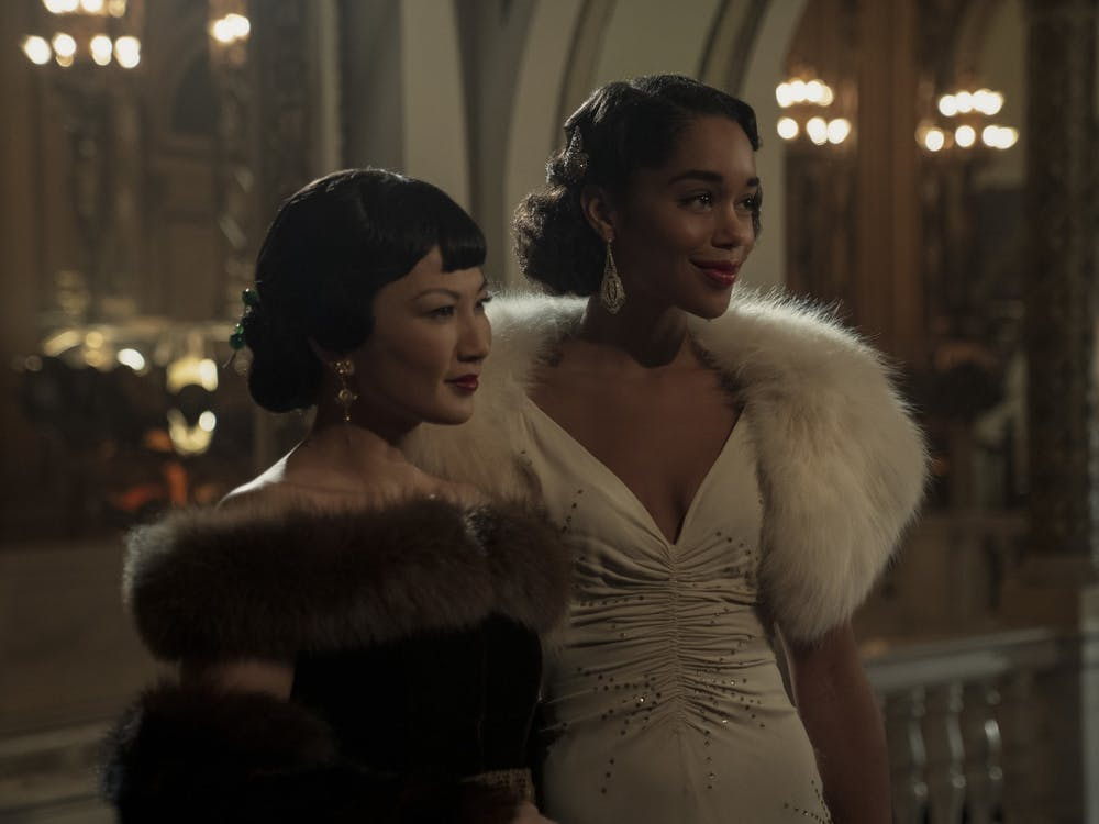 "Actresses Michelle Krusiec and Laura Harrier act in the television series ""Hollywood."" Krusiec's character is a portrayal of Chinese American actress Anna May Wong."