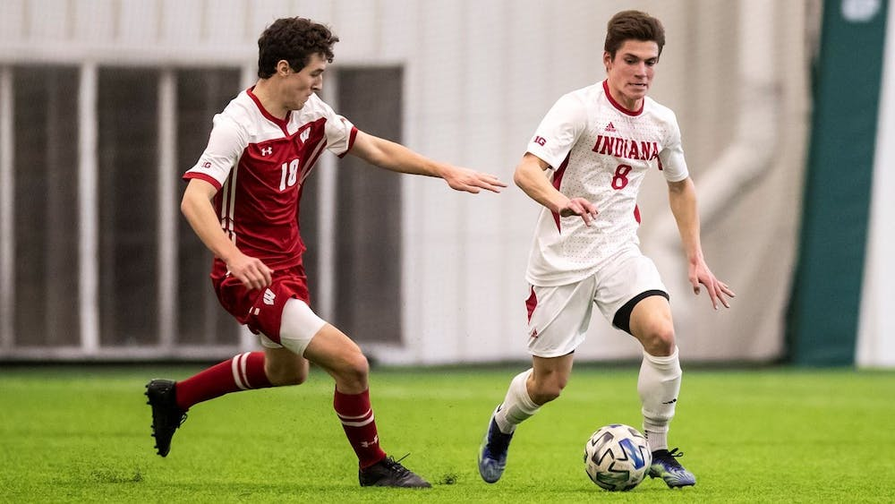 <p>Sophomore forward Joe Schmidt runs the ball up the field Feb. 19 at Grand Park in Westfield, Indiana. IU lost 1-0 to Northwestern Saturday in Evanston, Illinois. </p>