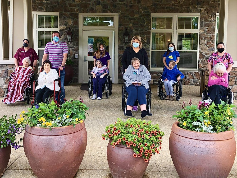 <p>Residents of the Autumn Hills Alzheimer&#x27;s Special Care Center smile for a photo. The center received one of  14 iPads that University Information Technology Services donated to hospitals and nursing homes in Monroe County.</p>