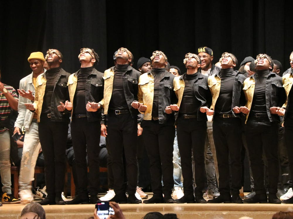 New members of Alpha Phi Alpha are introduced onstage at the fraternity's probate 7 p.m. Sunday night in Alumni Hall. The members sang, danced and greeted other National Pan-Hellenic Council fraternities and sororities.
