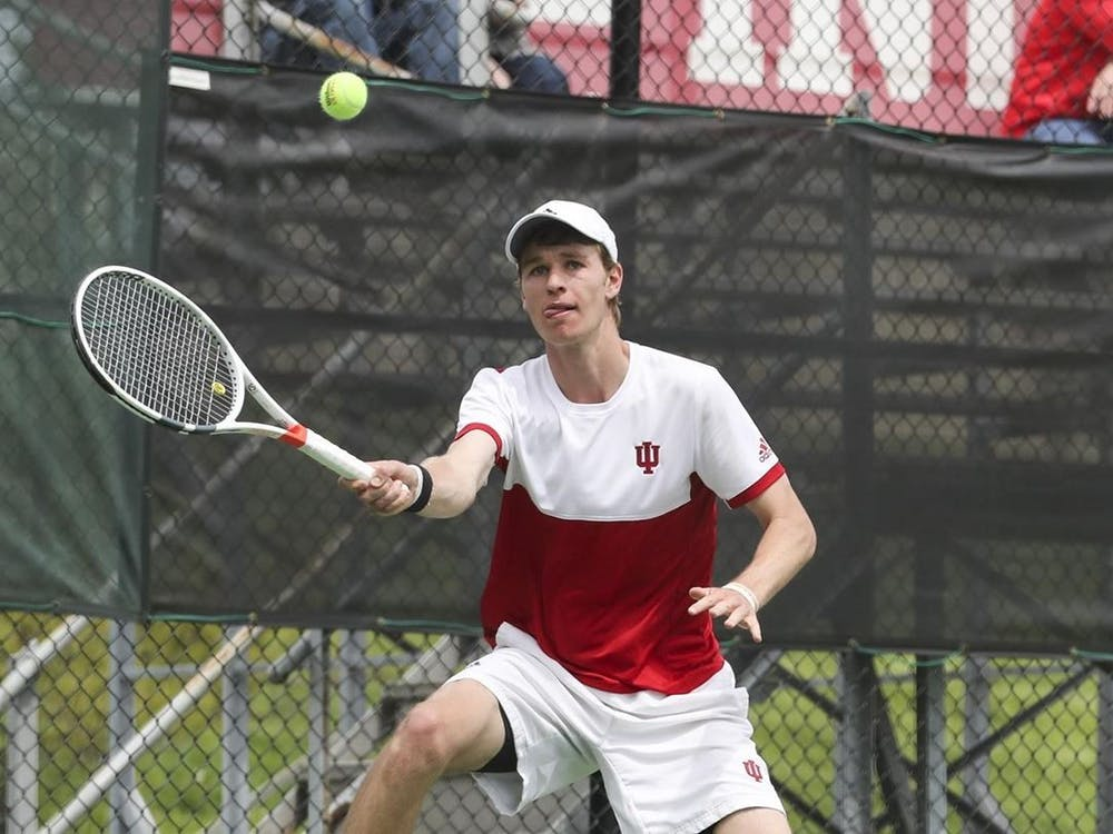 IU graduate student Bennett Crane prepares to hit the ball in a match against Nebraska on Feb. 21. The Hoosiers will compete against Michigan on Saturday.