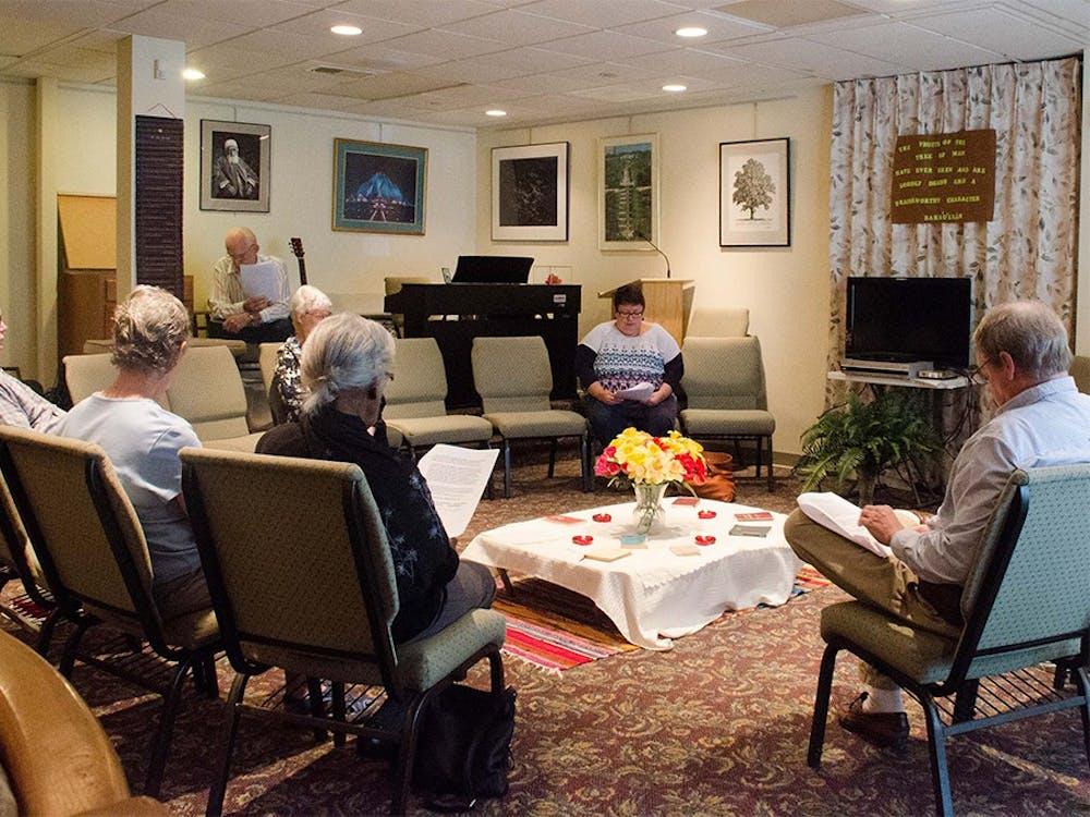 Members of the Bahá'í Faith community of Bloomington read passages during an interfaith devotional time Sunday.