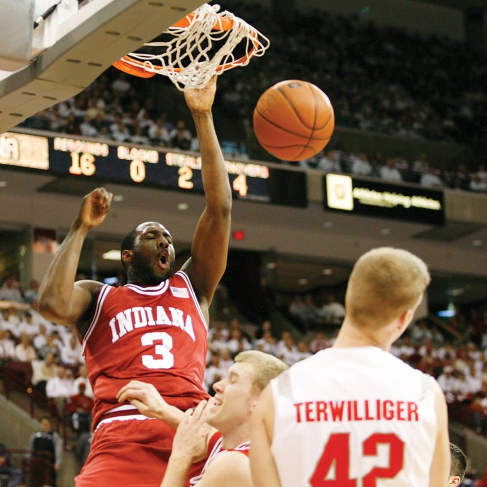IDS FILE PHOTOSenior forward D.J. White slams the ball over teammate Lance Stemler and Ohio State's Matt Terwilliger (42) Sunday, Feb. 10 in Columbus, Ohio. White, and former IU guard Eric Gordon, are expected to be drafted in Thursday's NBA Draft.