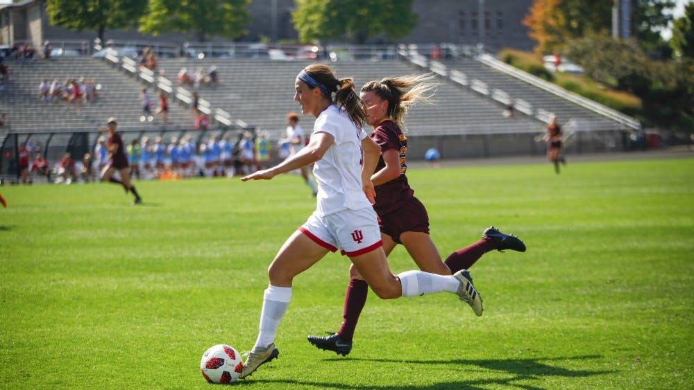 Senior Abby Allen moves the ball down the field and tries to keep it away from junior Marisa Windingstad on Oct. 7 at Bill Armstrong Stadium. IU defeated Minnesota, 3-2.