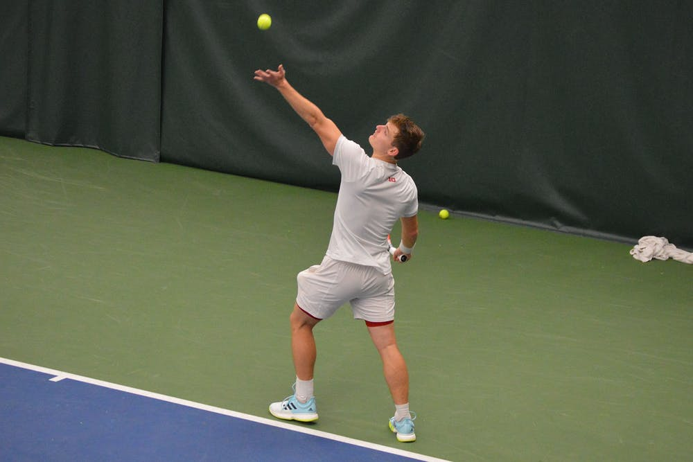 <p>Then-senior Andrew Redding serves the ball April 11, 2021, at the IU Tennis Center. Indiana sophomores Michael Andre and Ilya Tiraspolsky won three of their four doubles matches during the Drobac/Beeman Invite in East Lansing, Michigan, over the weekend. </p>