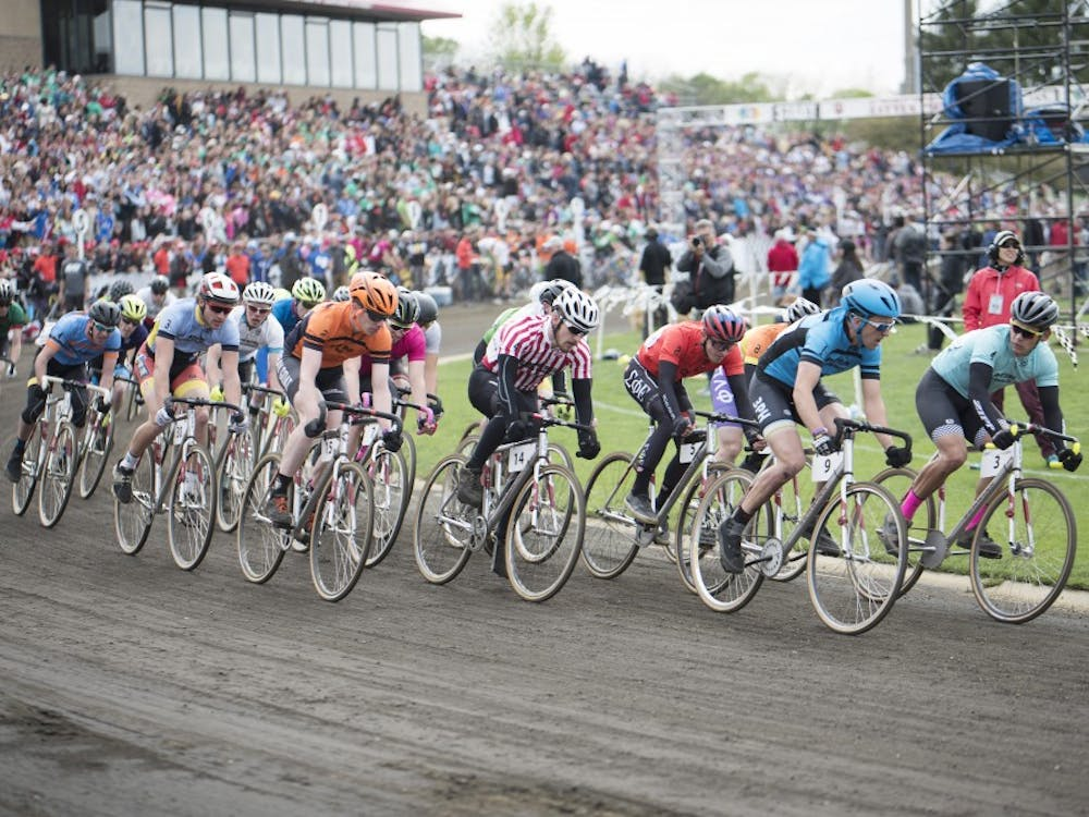 Riders in the pack ride their final laps at the men's race on April 22, 2017. The first race, featuring only men, happened in 1951.