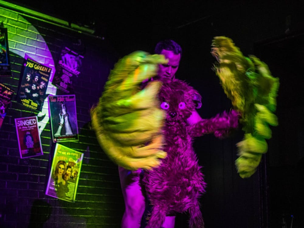 Bazuka Joe performs a routine with Mortimer the Monster, a large puppet July 20 at the Back Door. Bazuka Joe is a boylesque performer, a subsection of burlesque specifically for men.