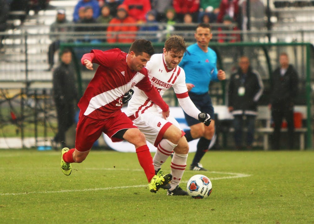 <p>Then-junior, now senior midfielder Austin Panchot fights for possession of the ball during the Big Ten Championship match against Wisconsin last year. IU opens conference play against Wisconsin on Sunday at 4 p.m.</p>