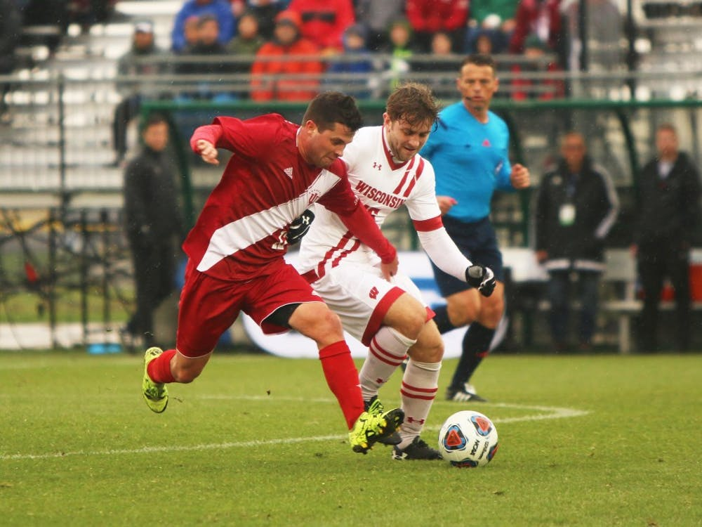 Then-junior, now senior midfielder Austin Panchot fights for possession of the ball during the Big Ten Championship match against Wisconsin last year. IU opens conference play against Wisconsin on Sunday at 4 p.m.
