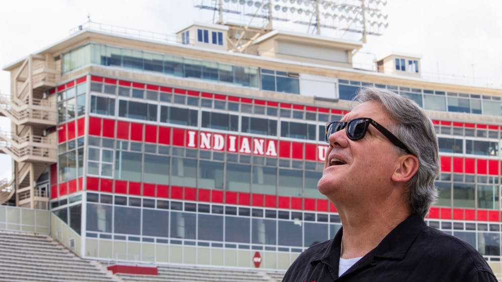 Then-IU Athletic Director Fred Glass looks up at the new south end zone scoreboard July 25, 2018, at Memorial Stadium. Glass was hired by IU in 2008.