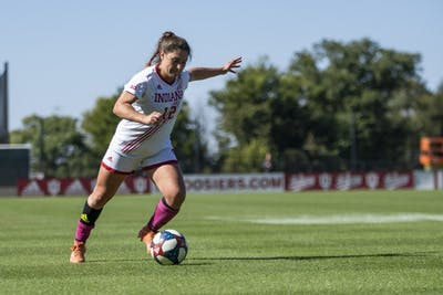 Junior Melanie Forbes attempts to kick the ball toward a teammate closer to the goal Oct. 13 at Bill Armstrong Stadium. IU had a doubleheader of women's and men's soccer.