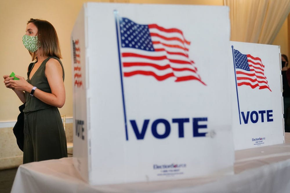 <p>A woman waits in line to vote in Georgia&#x27;s primary election on June 9 in Atlanta. Kelley School of Business professors wrote a report that was accepted by Washington and Lee Law Review in March, which addressed voting security and how the U.S. can better protect its voting process.</p>