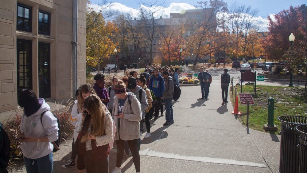 Students line up to vote outside the Indiana Memorial Union on Nov. 6, 2018. Students can find on-campus and online options to register Tuesday for National Voter Registration Day.