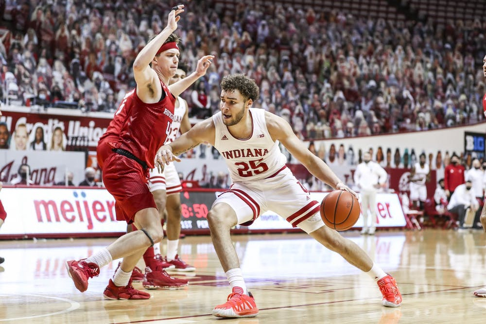 <p>Redshirt junior forward Race Thompson dribbles around a Rutgers player Jan. 24 at Simon Skjodt Assembly Hall. Thompson is the fourth IU basketball player to enter the transfer portal recently. </p>