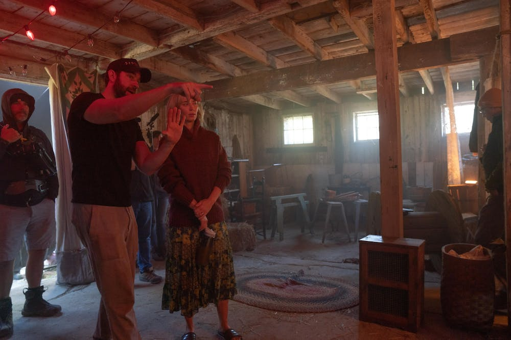 <p>Director John Krasinski speaks to his wife Emily Blunt while directing &quot;A Quiet Place: Part II.&quot; The movie will premiere March 20.  </p>