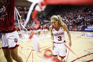 Senior Tyra Buss celebrates midcourt after winning the WNIT Championship game Saturday at Simon Skjodt Assembly Hall. The Hoosiers beat Virginia Tech, 65-57. Buss just signed a contract with Sporting Anthens in the Greek Women's Second Division.
