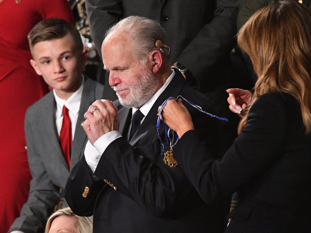 Then-First Lady Melania Trump delivers the Medal of Freedom to radio personality Rush Limbaugh on Feb. 4, 2020, at the U.S. Capitol in Washington. Limbaugh, 70, died Wednesday.