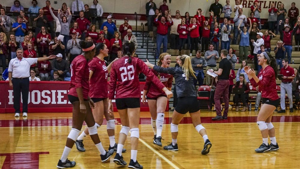 The IU women's volleyball team rushes to celebrate its victory against Rutgers on Oct. 13 in University Gym. IU is 15-10 overall this season.