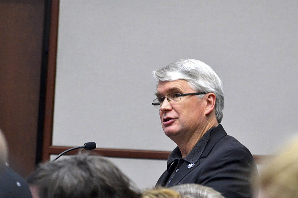 <p>Mayor John Hamilton speaks during the Bloomington City Council meeting Nov. 14 in City Hall. Hamilton spoke in support of the proposal for two new parking garages to be built in Bloomington.</p>