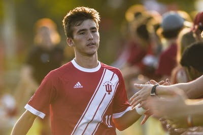Freshman Joshua Penn high-fives fans prior to the start ofIU's match against the University of Notre Dame on Sept. 17 at Bill Armstrong Stadium. IU will play Wisconsin on Sept. 20 in Bloomington.