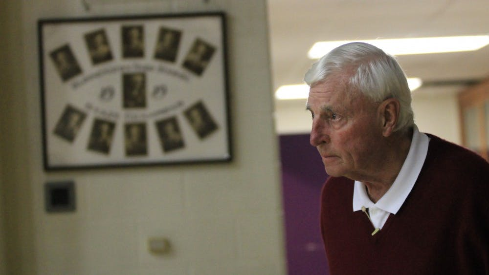 Former IU men's basketball coach Bob Knight waits on the sidelines of the basketball court at Bloomington High School South on Feb. 28, 2018. Knight returned to IU's campus Saturday afternoon to take in a baseball game at Bart Kaufman Field.