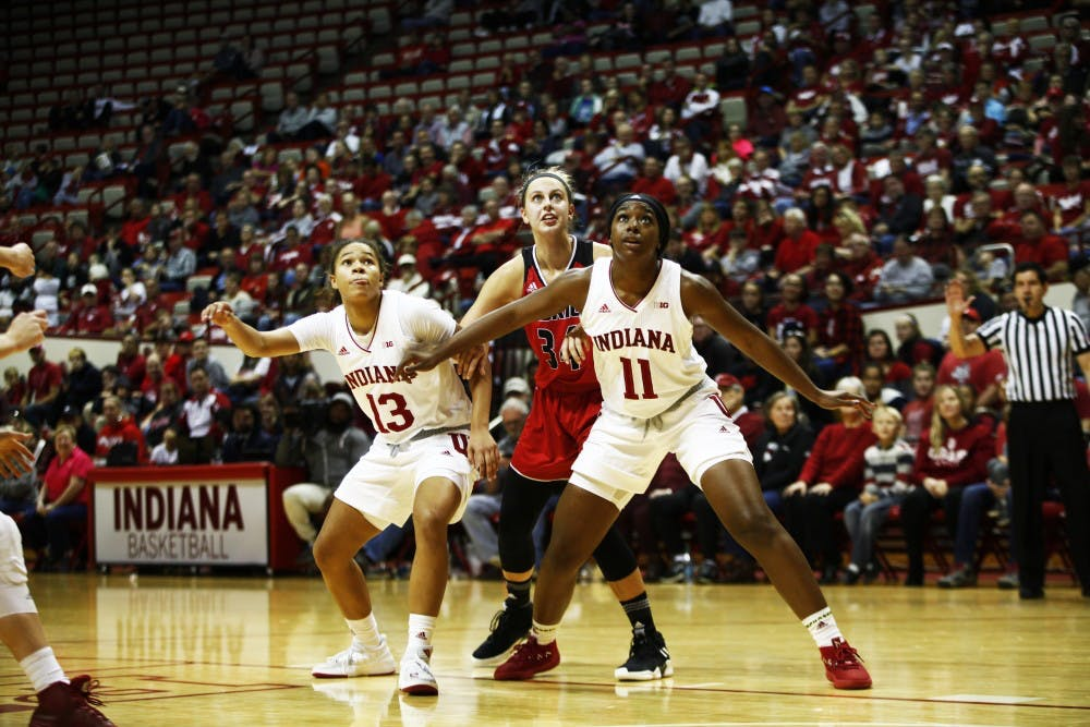 <p>Sophomore Jaelynn Penn and senior Kym Royster box out freshman Christina Britter on Nov. 25 in Simon Skjodt Assembly Hall. IU beat Northern Illinois University, 91-73.</p>