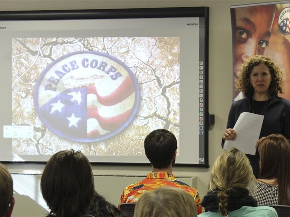 """Peace Corps Associate Director Helen Lowman tells her own story and introduces the """"Special Event: Peace Corps send off celebration and Returned Volunteer Panel"""" on Wednesday at the Career Development Center. Volunteers shared their stories and experiences during the event."""