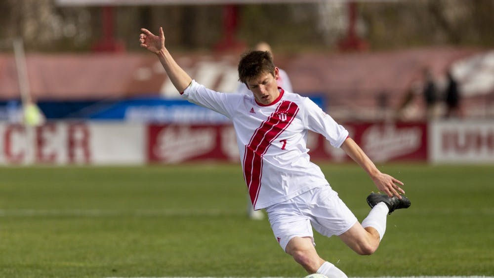 Senior midfielder Trevor Swartz goes to cross the ball Nov. 25 at Bill Armstrong Stadium during the third round of the NCAA Tournament against the Air Force. The Hoosiers defeated the Falcons, 2-0.