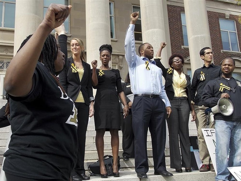 "Tyrell Conner, a leader of the Purdue Anti-Racism Coalition, leads the group in a chant, ""I am a Boilermaker!"" on Friday on the steps of Hovde Hall at Purdue University."