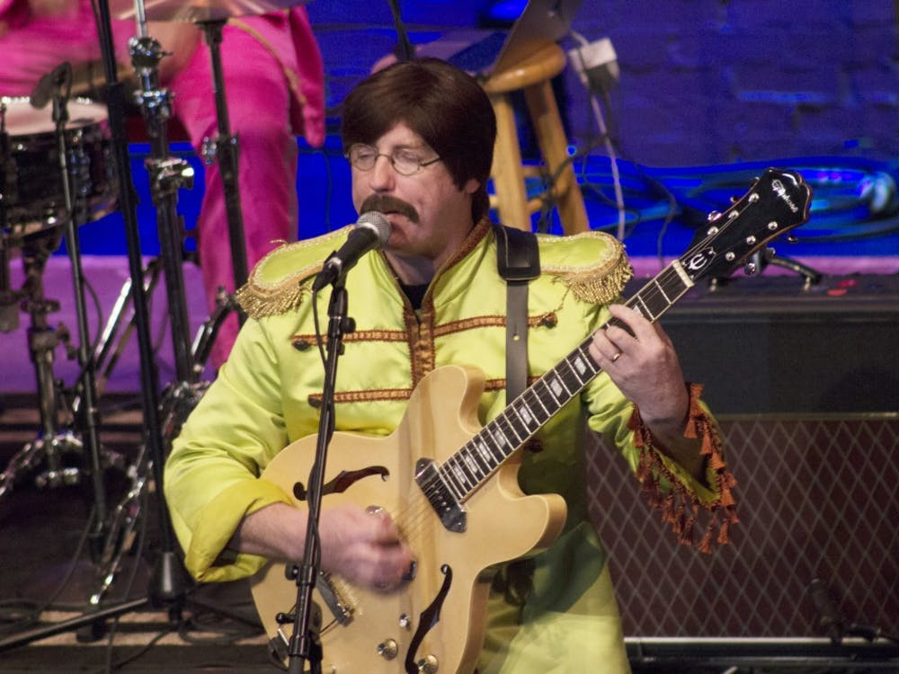 The Mersey Beatles play their set Friday night at the Buskirk-Chumley Theater, which was packed for the tribute band's third performance in Bloomington. All of the Mersey Beatles are from Liverpool, the hometown of the original Beatles quartet.