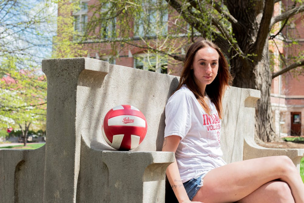 <p>Junior outside-hitter Kari Zumach sits at a bench on IU&#x27;s campus on April 15. Zumach has worked to learn more about mental health since her transfer to IU.</p>