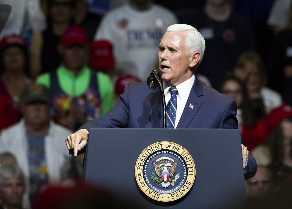 <p>Vice President Mike Pence talks with supporters at a rally May 10, 2018, at North Side Middle School in Elkhart, Indiana. Pence is visiting Bloomington on Tuesday to tour a vaccine production facility, his office announced Friday.</p>