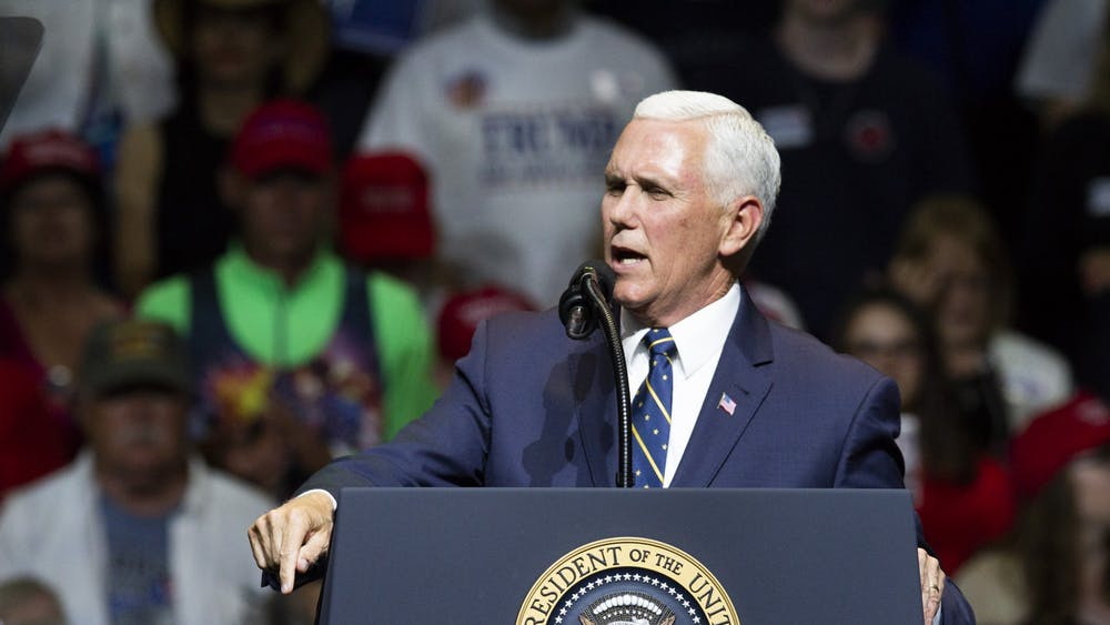 Vice President Mike Pence talks with supporters at a rally May 10, 2018, at North Side Middle School in Elkhart, Indiana. Pence is visiting Bloomington on Tuesday to tour a vaccine production facility, his office announced Friday.
