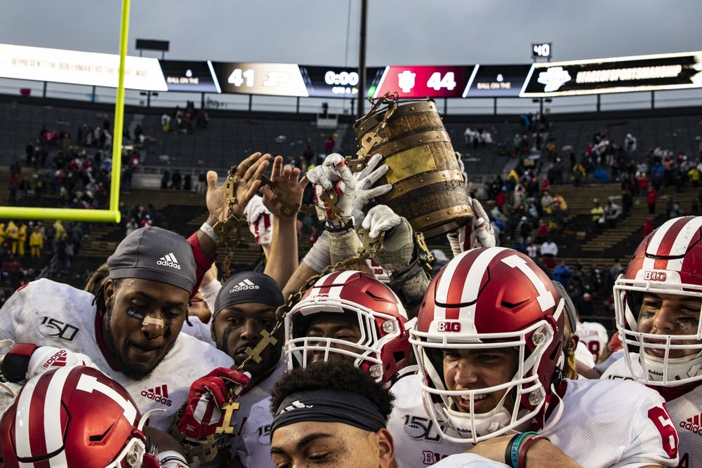 <p>IU football players hold up the Old Oaken Bucket after defeating Purdue on Nov. 30, 2019, in Ross-Ade Stadium. Purdue canceled practice Tuesday after COVID-19 testing in the football program, putting the game Saturday with No. 8 IU in jeopardy.</p>