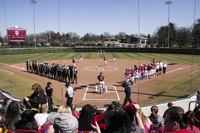 The IU and University of Iowa softball teams stand March 26, 2016, at Andy Mohr Field. The IU softball team spread #mightywithmicah on Twitter to welcome new graduate transfer Micah Schroder.