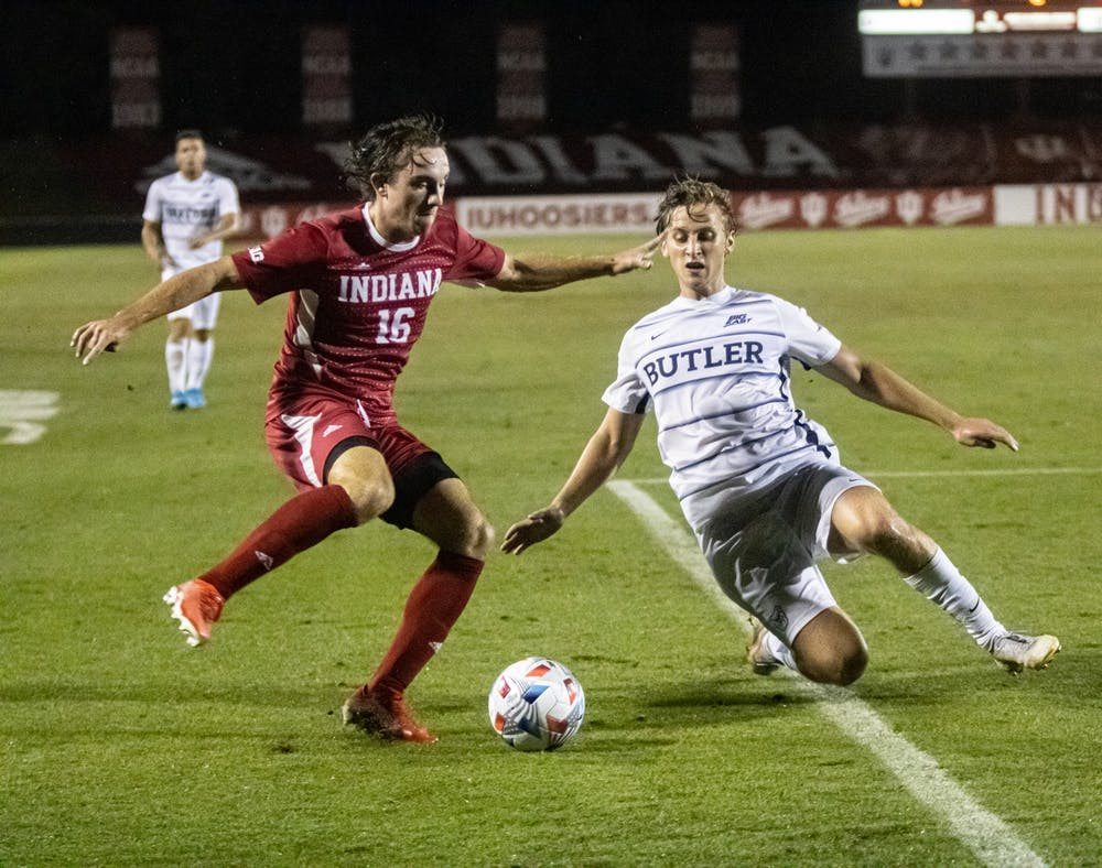 <p>Sophomore defender Lukas Hummel attempts to dribble past a Butler player Aug. 31, 2021, at Bill Armstrong Stadium. Hummel was one of 23 Hoosiers to play for Indiana men&#x27;s soccer Saturday night. </p>