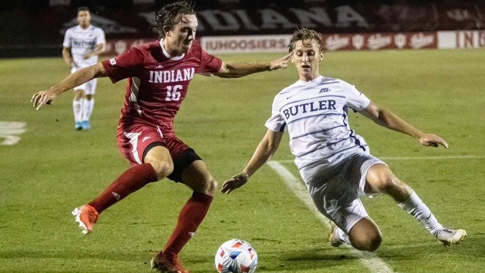 Sophomore defender Lukas Hummel attempts to dribble past a Butler player Aug. 31, 2021, at Bill Armstrong Stadium. Hummel was one of 23 Hoosiers to play for Indiana men's soccer Saturday night.