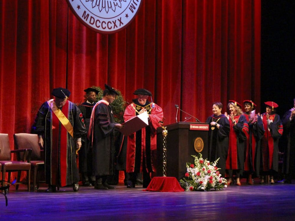 """Kenneth """"Babyface"""" Edmonds receives an honorary doctoral degree from President Michael McRobbie. Edmonds was given the degree Oct. 18 at the IU Auditorium."""